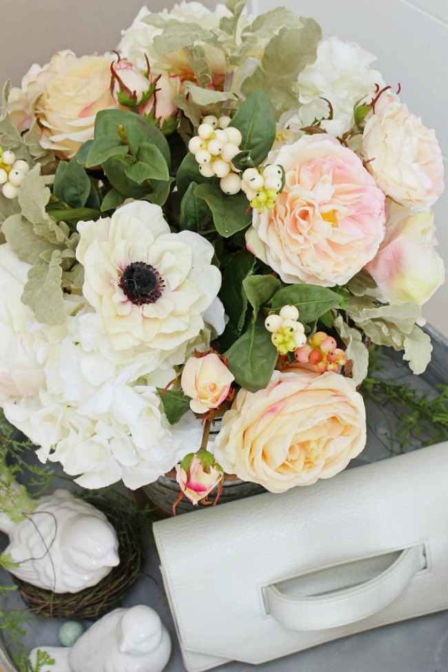 White and pink faux flower arrangement.