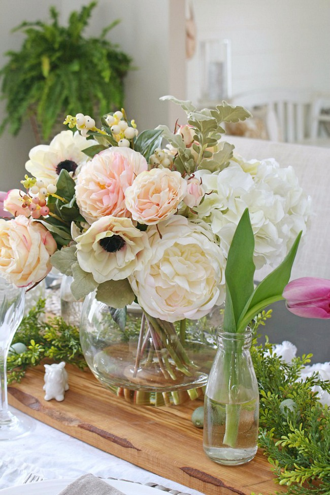 Beautiful spring centerpiece with faux flowers.