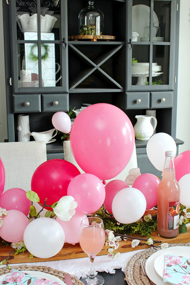 Pretty balloon centerpiece with pinks and whites. Mother's Day tablescape.