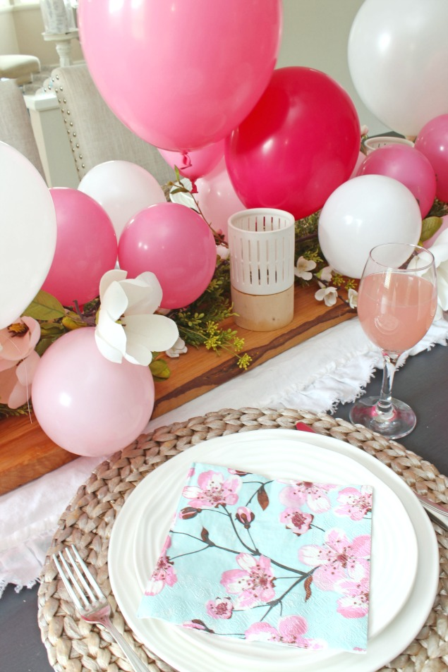 Pretty Mother's Day tablescape with a pink balloon centerpiece.
