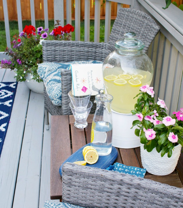Summer patio with wicker chairs and lemonade bar.