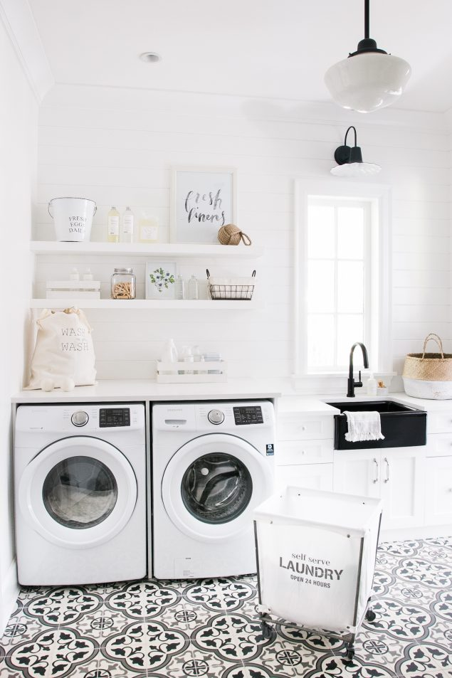 Beautiful white laundry room design with modern farmhouse touch.