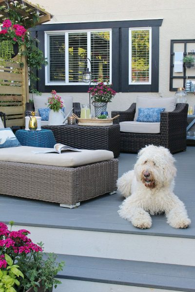 Beautiful summer backyard patio ideas. Resin wicker patio furniture and Trex decking.