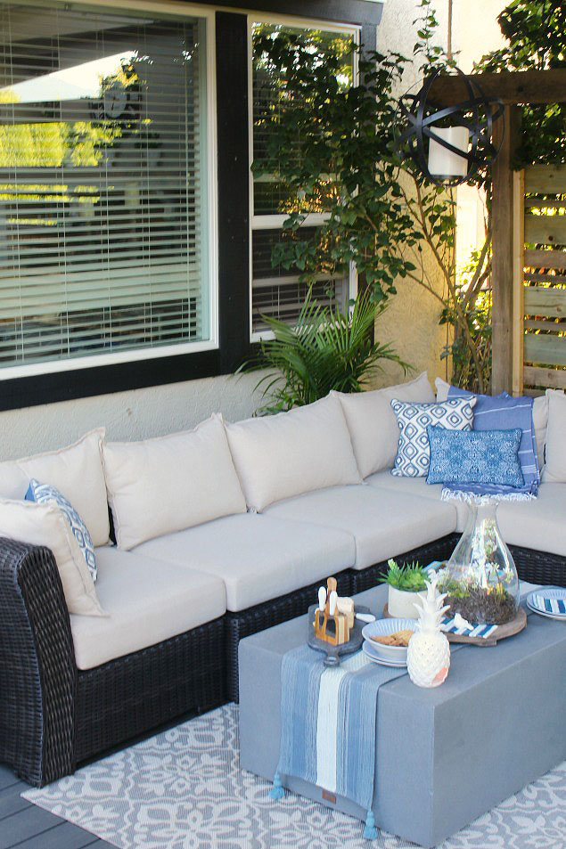 Beautiful covered summer patio with outdoor sofa.