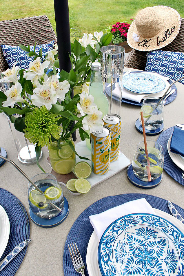 Beautiful outdoor summer tablescape with blue and yellow decor.