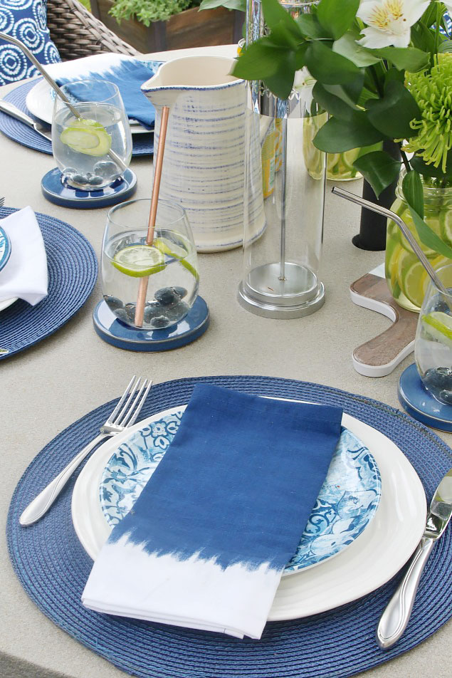 Pretty summer tablescape with blue and white dishware.