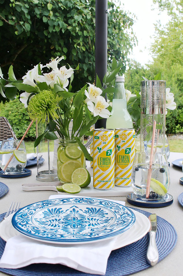 Beautiful summer tablescape with blue and white place settings.