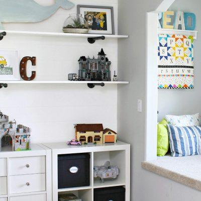 Kids Bedroom Organization. Reading nook and Ikea storage unit to keep toys organized.