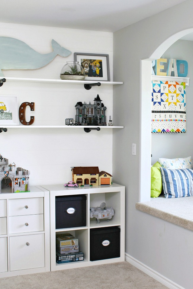 Kids' Bedroom Organization Ideas. Ikea shelving unit to keep toys organized and a cute reading nook.