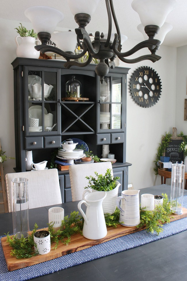 Farmhouse style dining room with blue, white, and greens.
