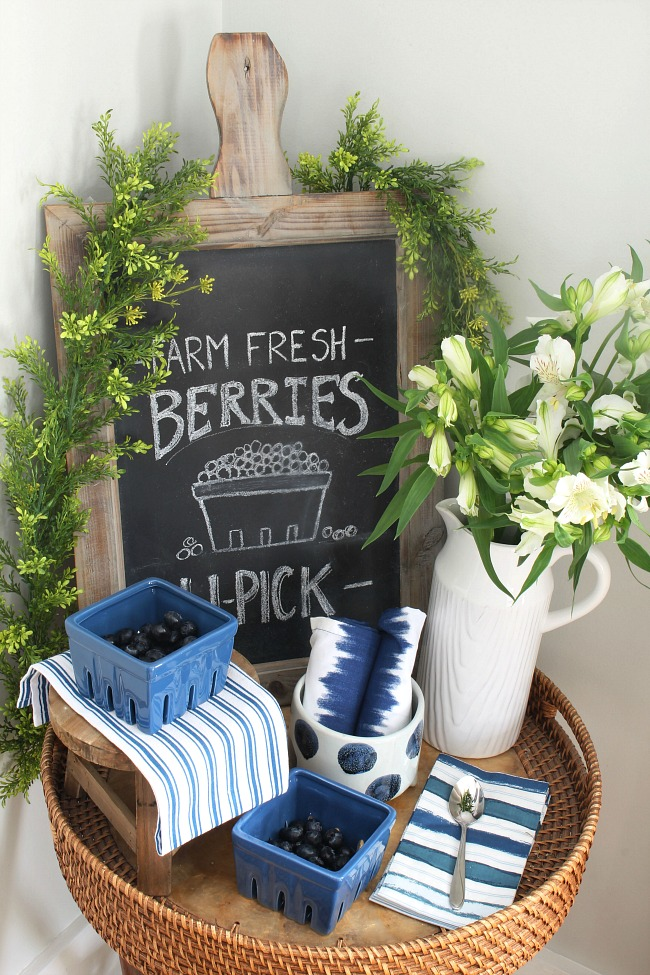 Farmhouse style dining room with blue, white, and greens. Love the summer chalkboard.