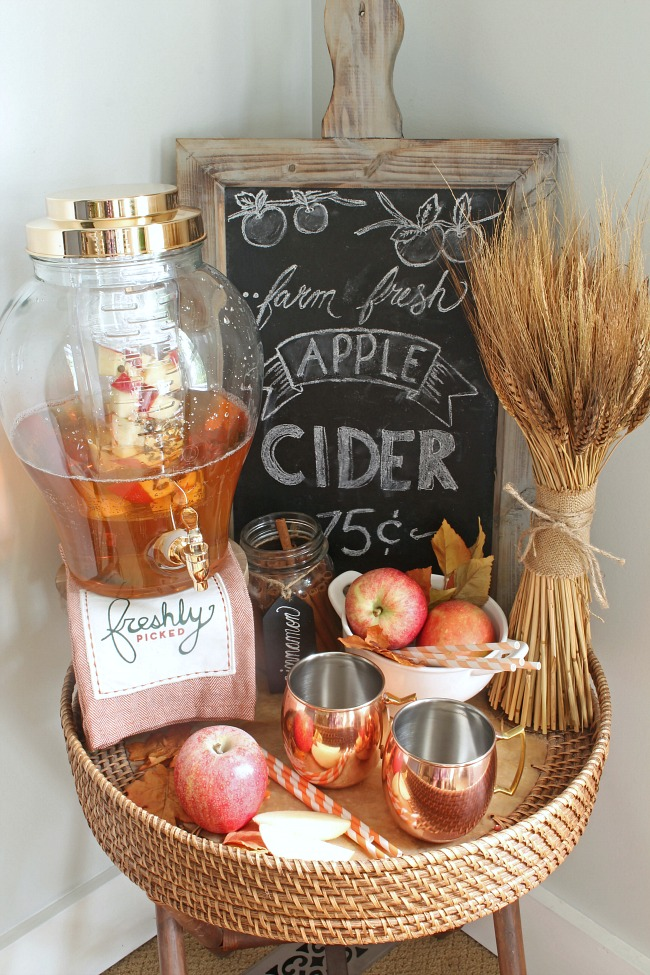 Fall apple cider bar with apple cider chalkboard art.