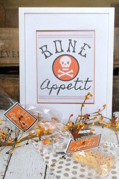 Bone Appetit free Halloween printable displayed in a frame with smaller bag toppers in front.