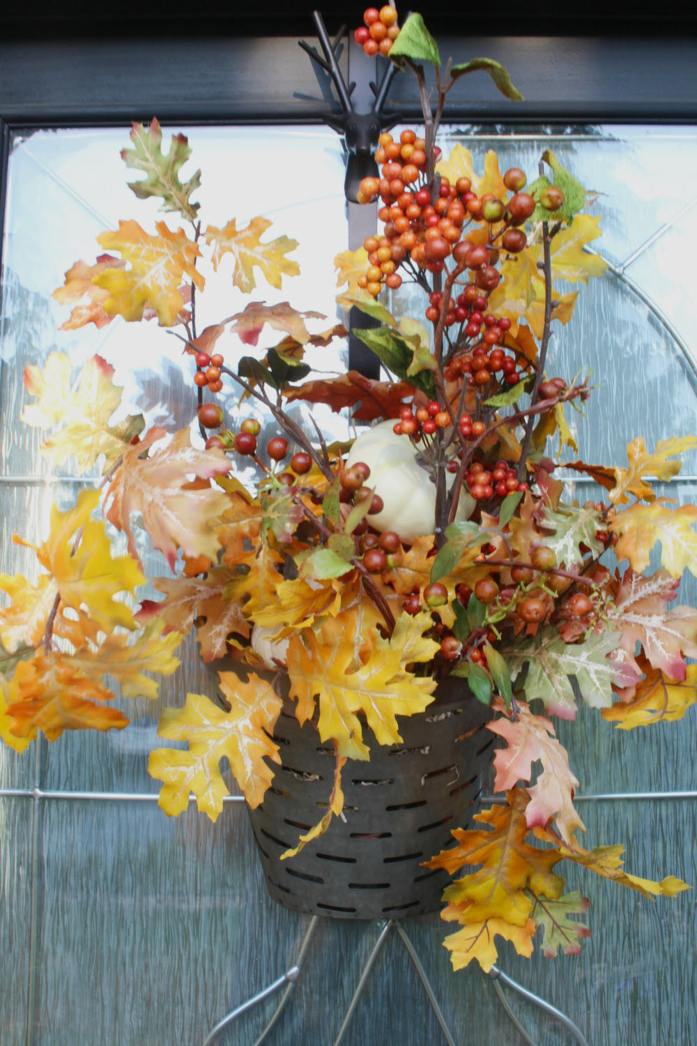 Cute alternative to a traditional fall wreath.