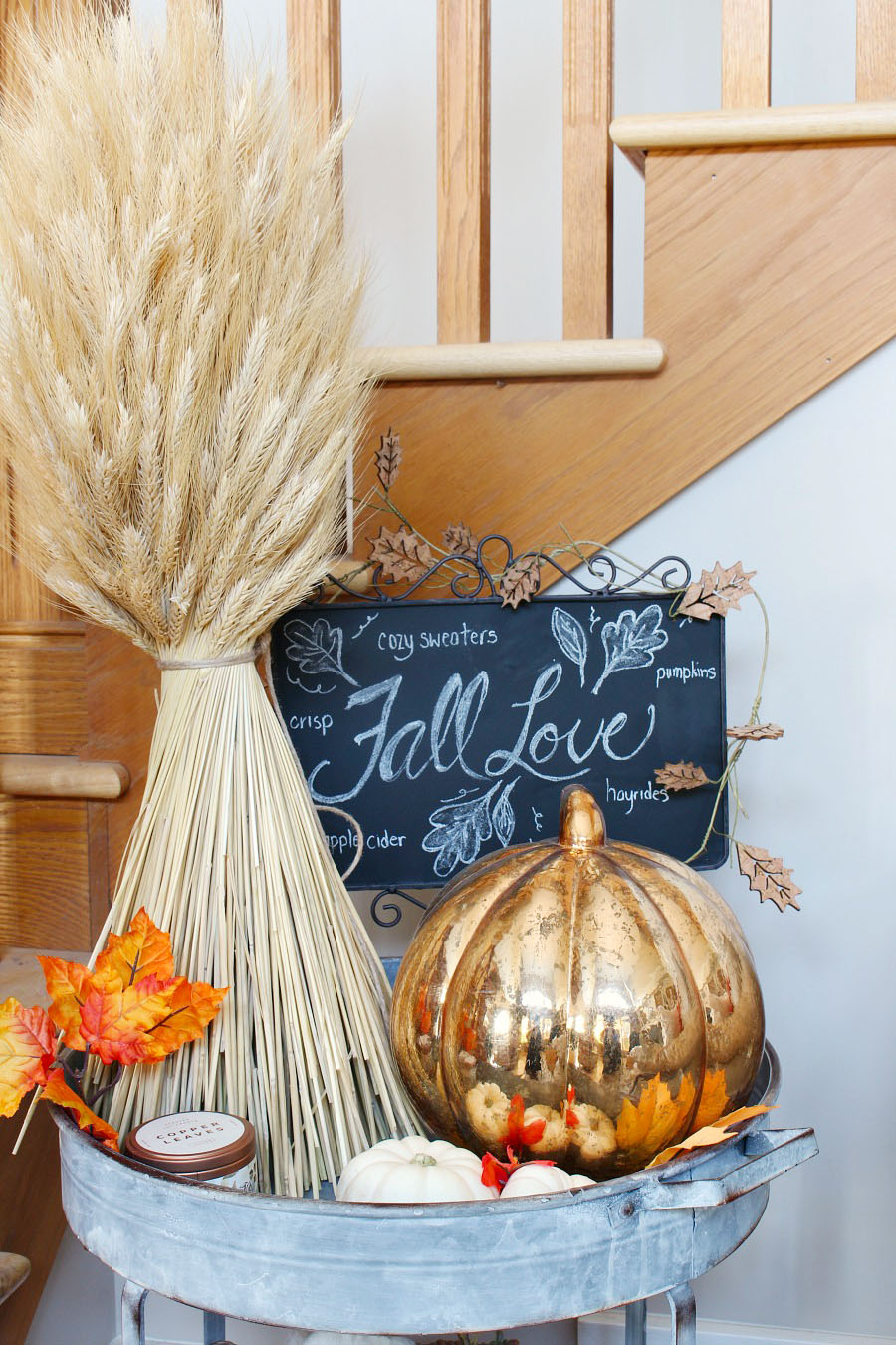 Family Room Fall Decorating Ideas with a cute fall chalkboard. Easy fall decorations in traditional autumn colors with pops of blue.