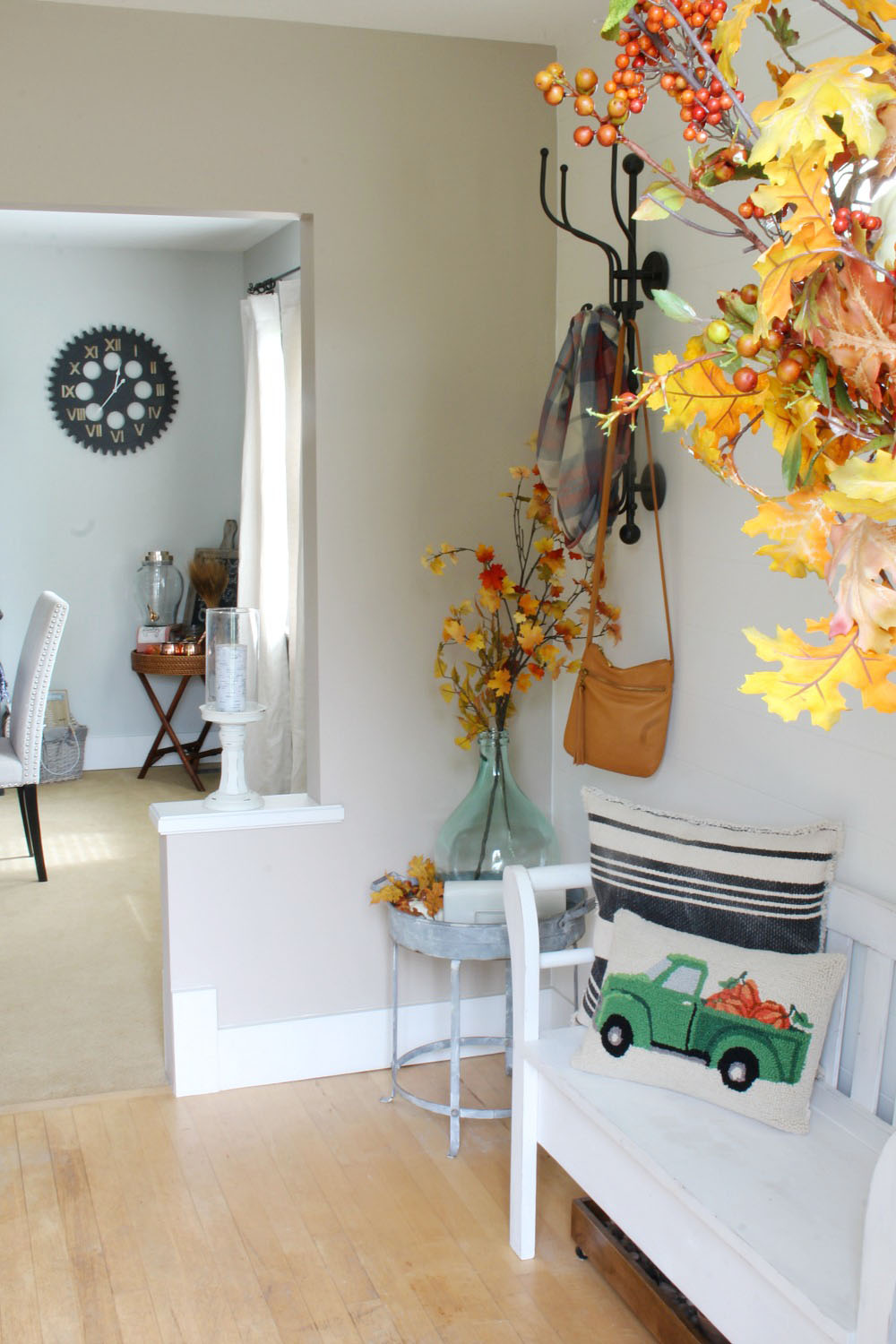 Fall front entry decorating ideas. Create a welcome entry for family and friends with these simple ideas to dress up your front entry for fall.