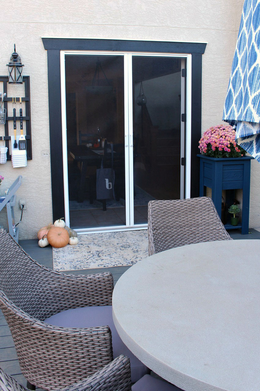 Fall patio decor with retractable screen doors.
