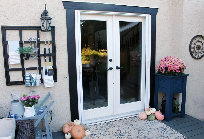 Fall patio with retractable screen doors for french doors.