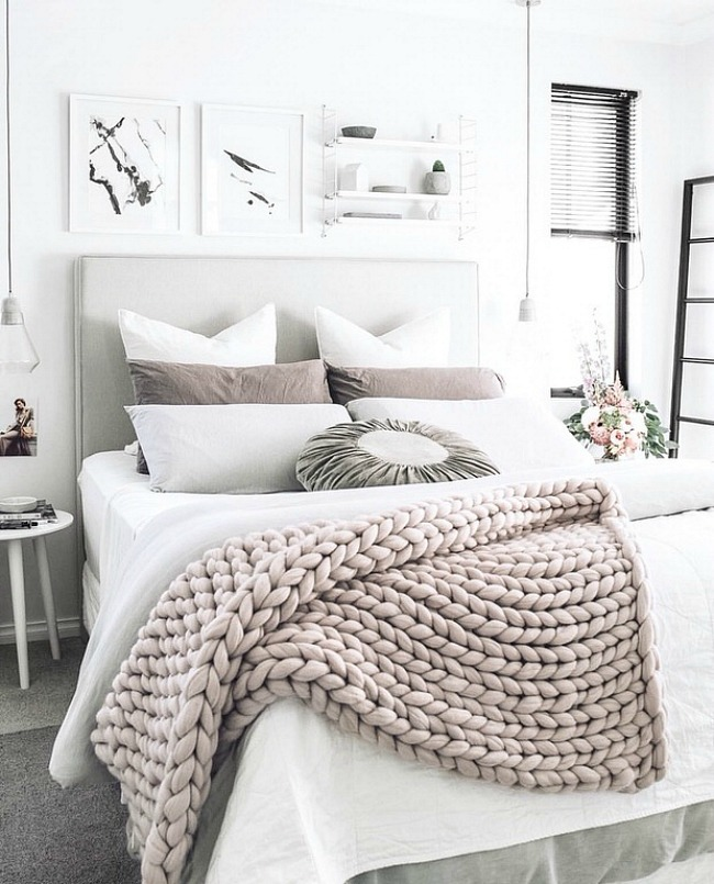 DIY a chunky knit blanket for a cozy and relaxing master bedroom.