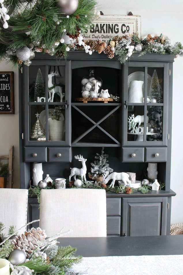 Gorgeous farmhouse style Christmas dining room with silver and white.