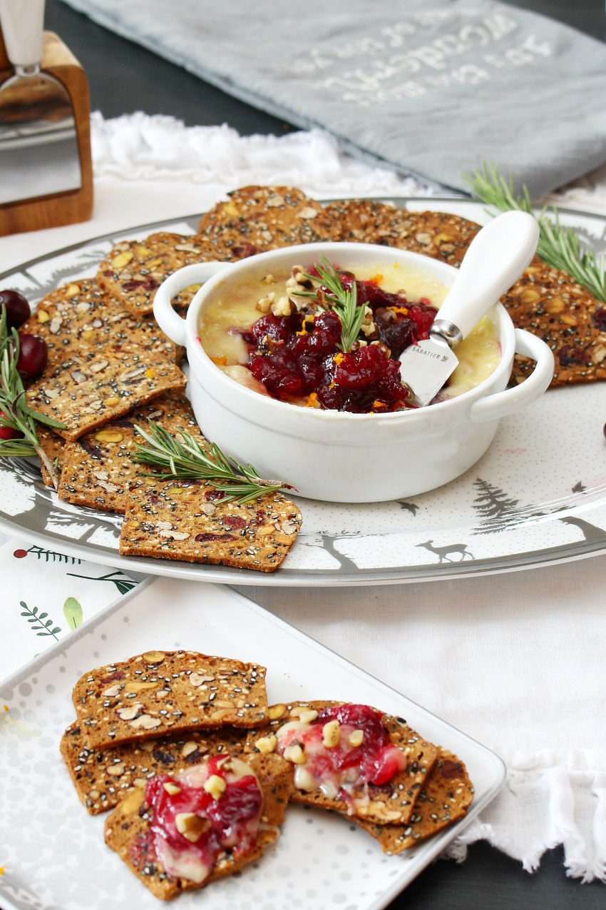 This delicious cranberry baked brie is simple to make and full of flavour - it's the perfect appetizer for those holiday parties and gatherings. You'll probably want to make extra of the homemade cranberry sauce for other recipes.