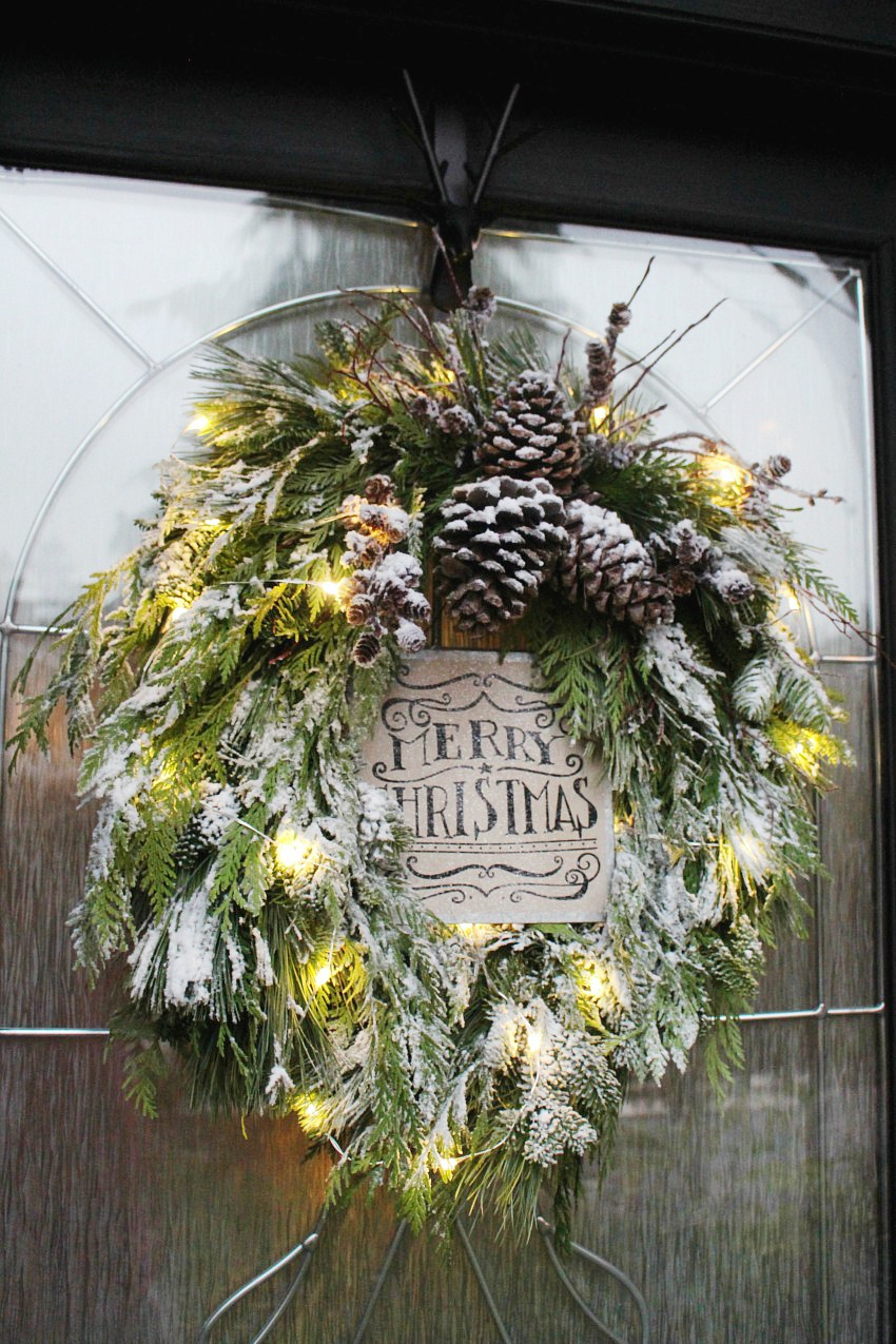 Fresh Christmas wreath with flocking. Remove the Christmas sign and it will last all winter!