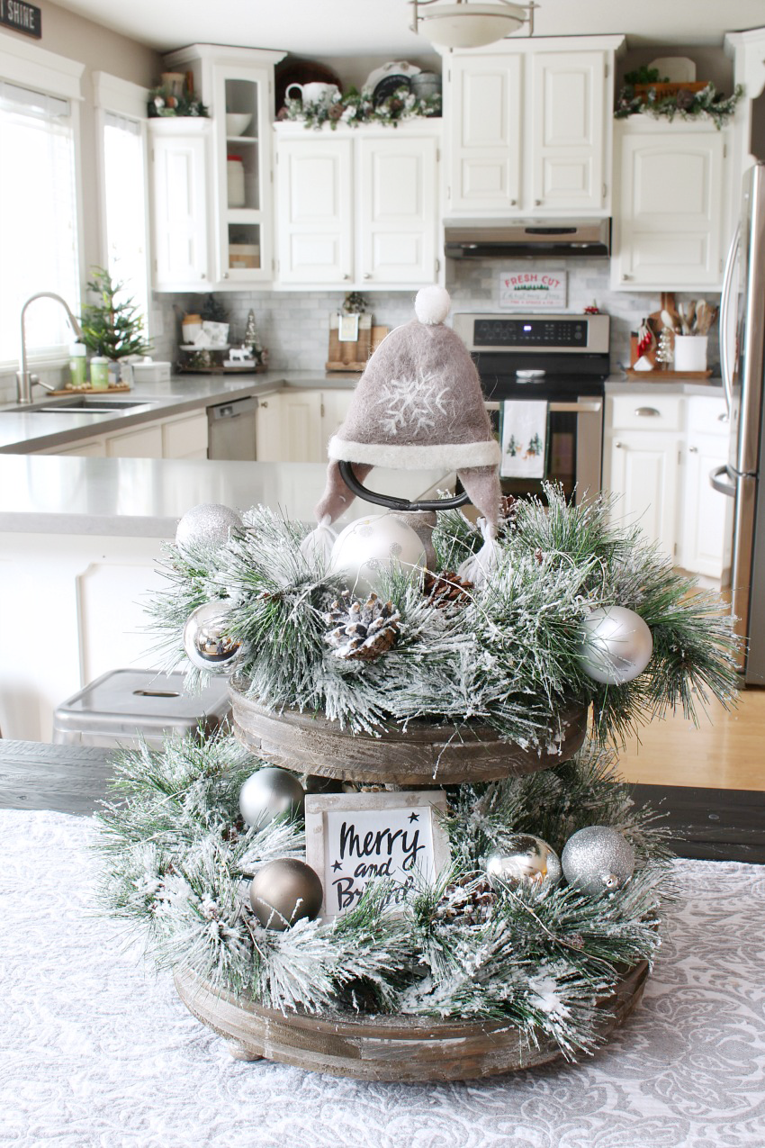Beautiful modern farmhouse Christmas tray.  Easy ideas to decorate a tray for Christmas using flocked greenery, neutral decorations and twinkle lights.