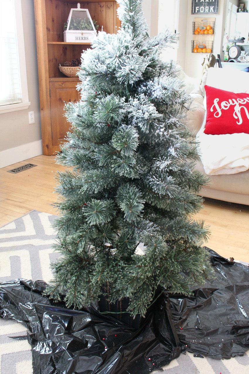 How to flock a Christmas tree. DIY tutorial to add that snow-covered look to trees, garlands, wreaths, and more!