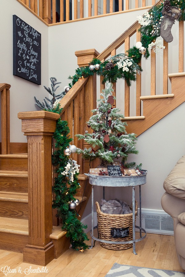 The easiest way to hang garland on the stairs.  Love this look.