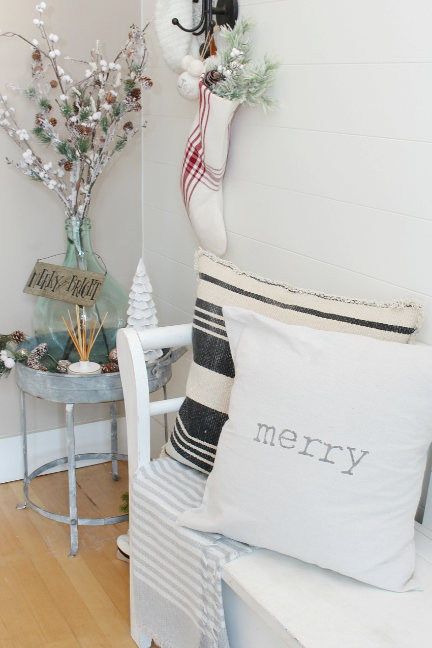 Christmas Front Entry Decorating Ideas. Pretty and simple ideas to dress up your front entry for the holidays. Love the red and white farmhouse feel!