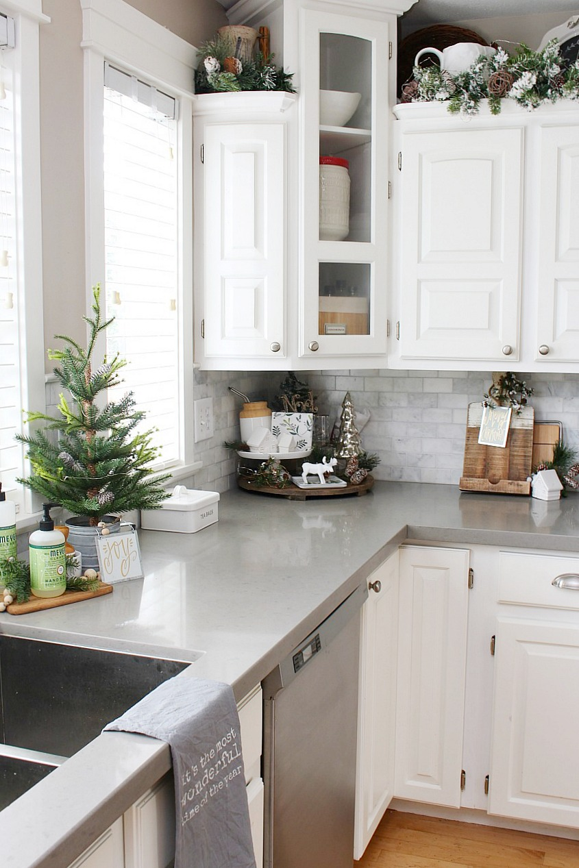 Kitchen Christmas Decorations. White kitchen dressed in frosted greens for a festive touch.