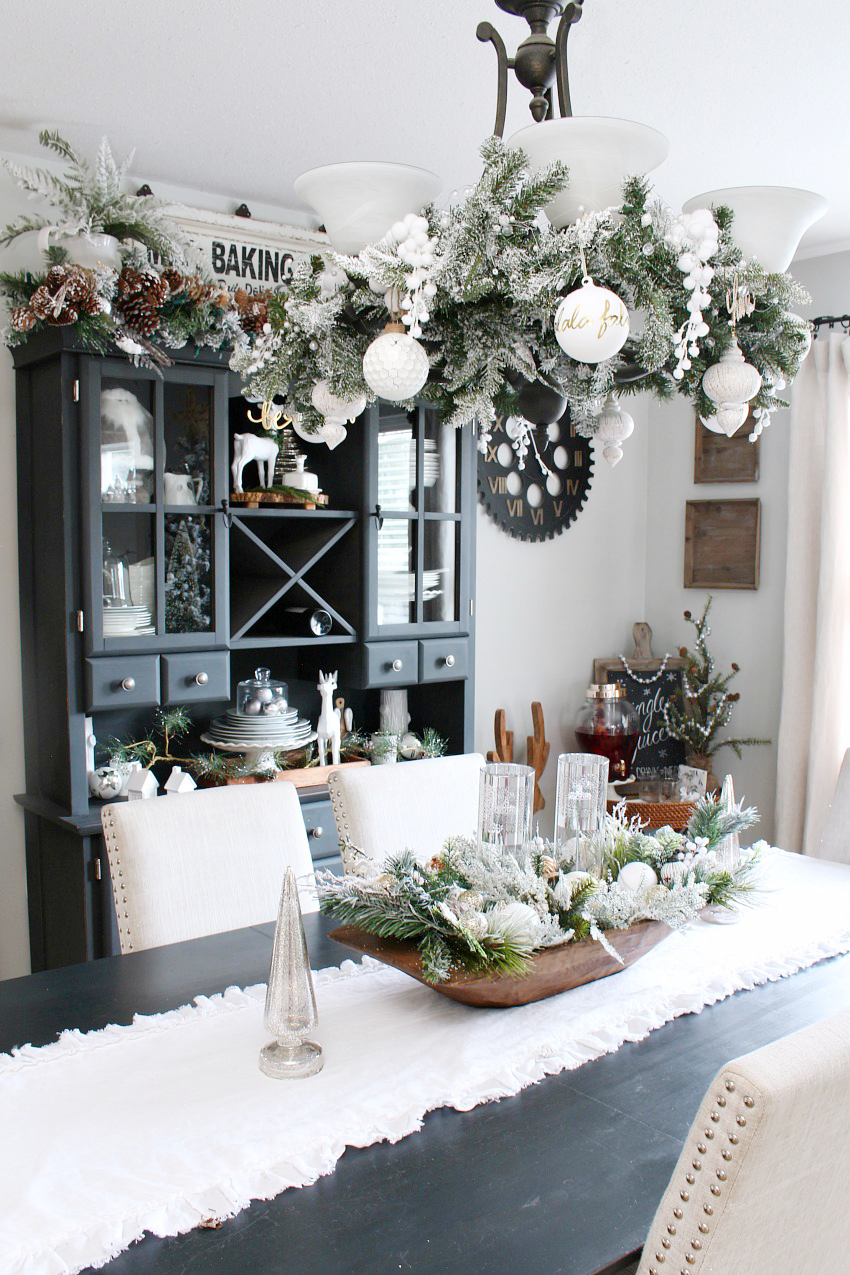 Beautiful Farmhouse Christmas Dining Room With A Snowy Winter Wonderland Feel Decorated In White