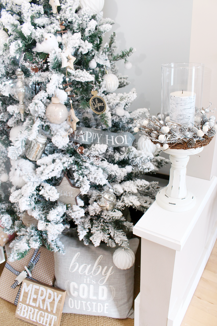 Beautiful flocked Christmas tree. Pretty Christmas decorating ideas for the dining room.