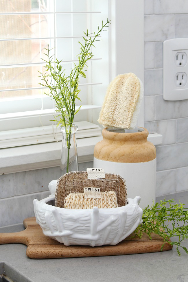 Use a soap dish to hold kitchen sponges for a pretty and functional look. #cleaningtips