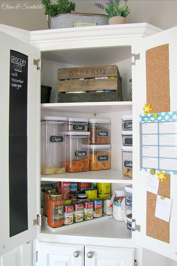 Organized kitchen pantry cupboard.
