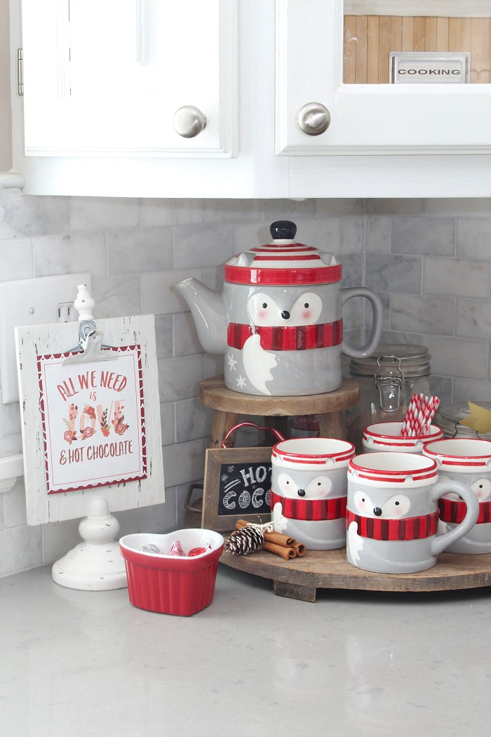 Adorable Valentine's Day hot chocolate bar with a raccoon mug set and free Valentine's Day hot chocolate bar printable.