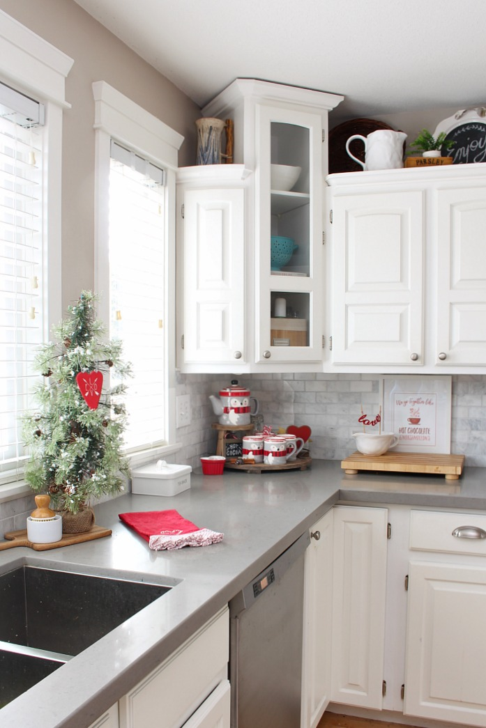 White farmhouse style kitchen decorated for Valentine's Day with a cute Valentine's Day hot chocolate bar.