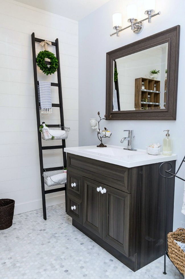 Farmhouse style bathroom with wooden storage ladder.