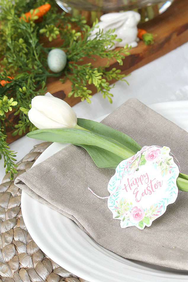 Easter place setting with a Happy Easter printable and tulip.
