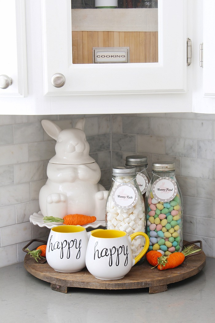 Easter hot chocolate bar with a white ceramic bunny cookies jar and milk bottles.