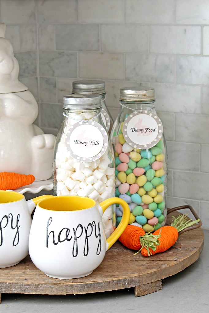 Easter hot chocolate bar with milk bottles filled with marshmallows and Easter chocolate.