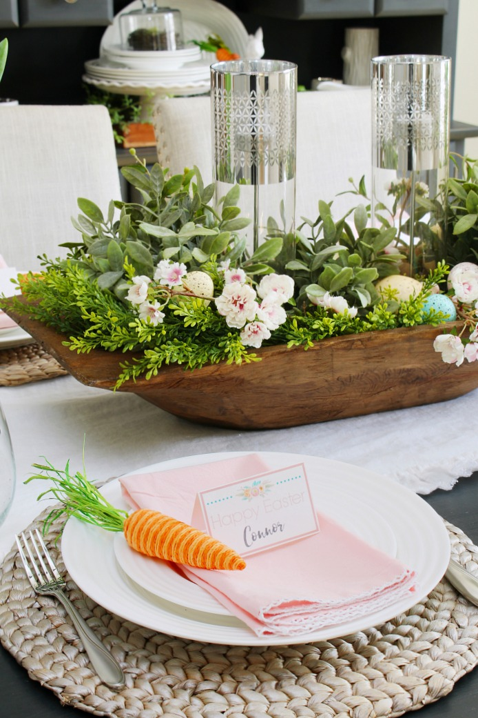 Farmhouse style table decorated for Easter with greens, pale pinks, and white.