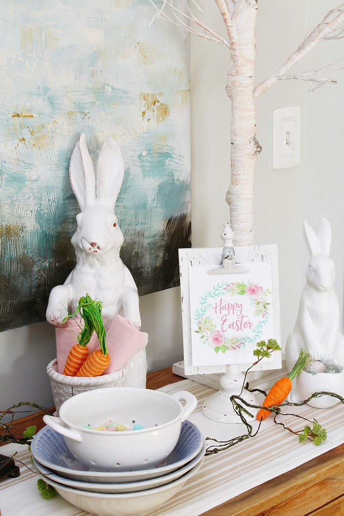 Easter display with white ceramic bunnies.