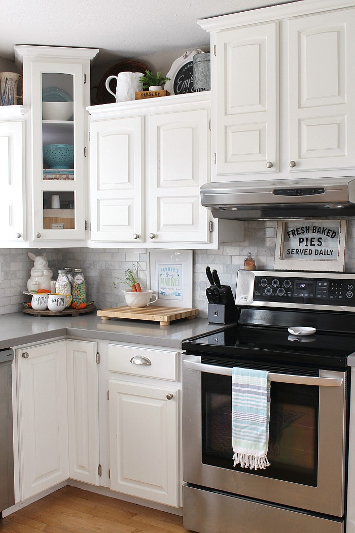 Farmhouse style white kitchen with spring decorations.