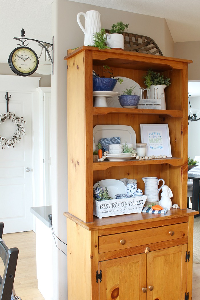 Wooden hutch decorated for spring.