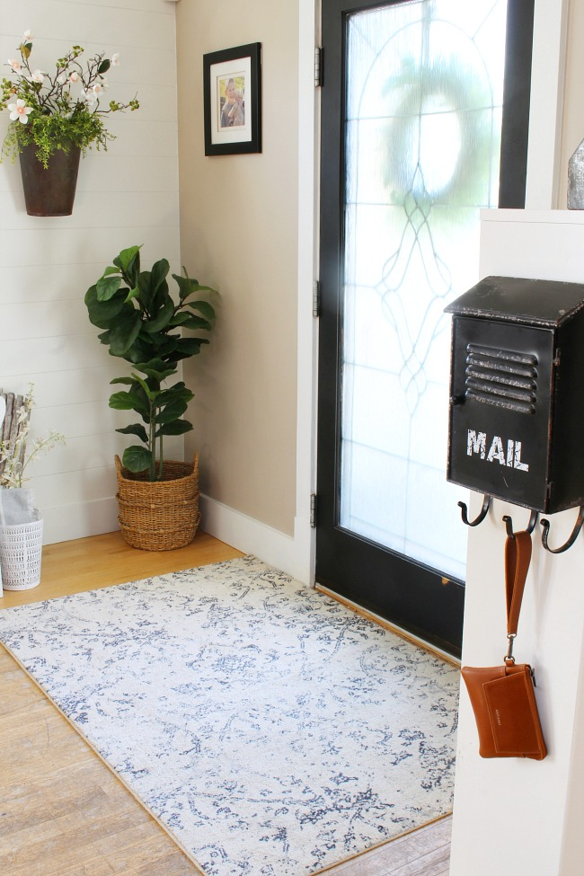 Front entry decorating ideas for spring. Farmhouse style front entry with Magnolia Home carpet.