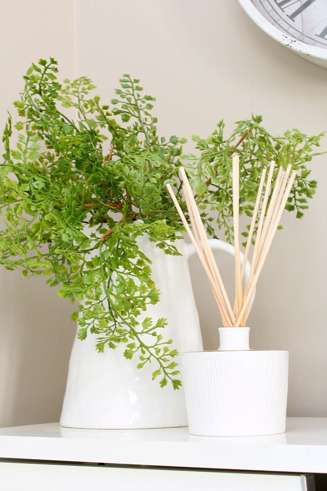 Spring front entry ideas. Faux greenery in a ceramic vase with diffuser.