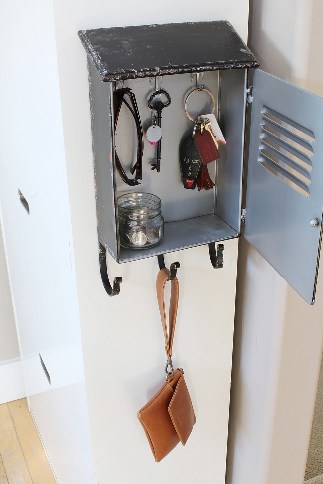 Faux mailbox with Command hooks to use as storage in a front entry.