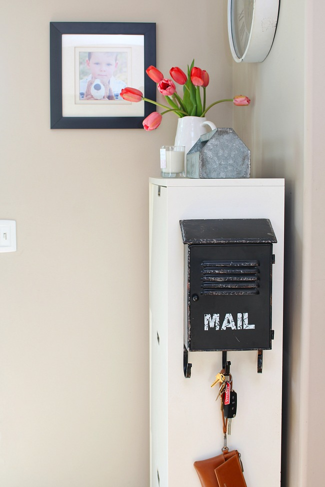 Spring front entry decorating ideas. Ikea shoe organizer with faux mailbox storage.