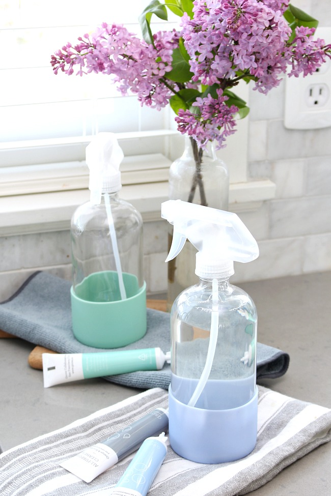Spray bottles displayed with Grove Collaborative cleaning concentrates.